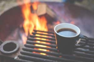 Cup of coffee and campfire
