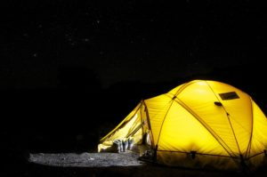 Yellow tent under a starry sky