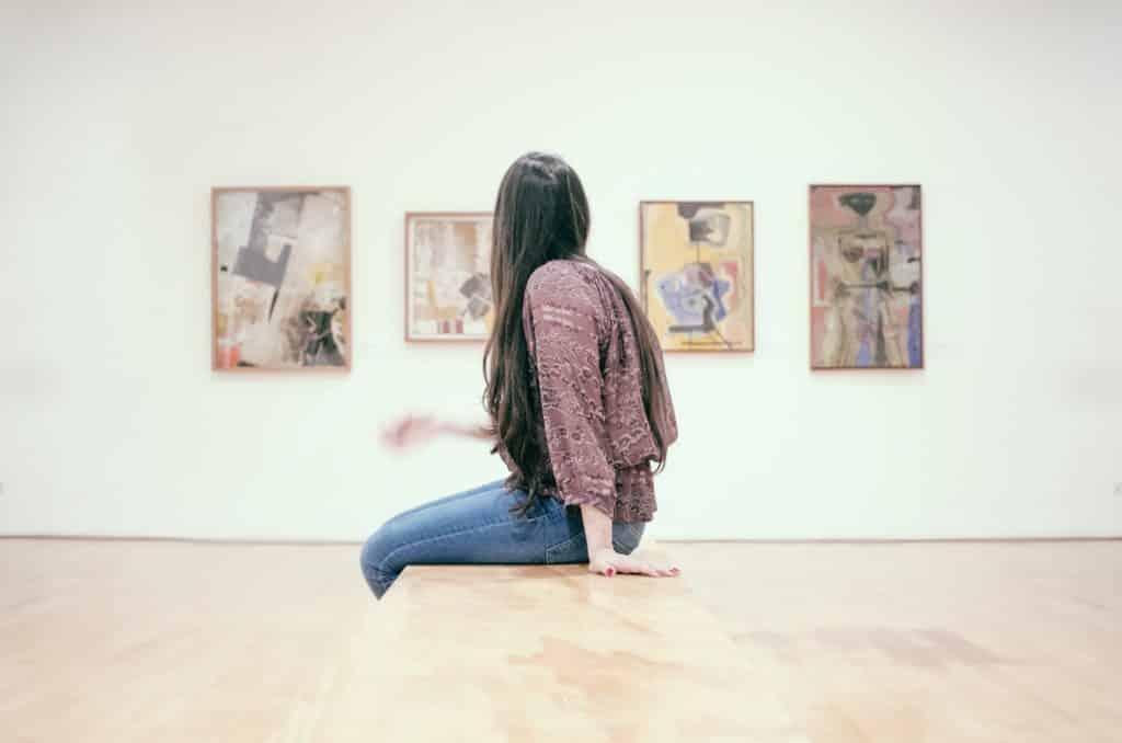 Woman sitting in an art gallery