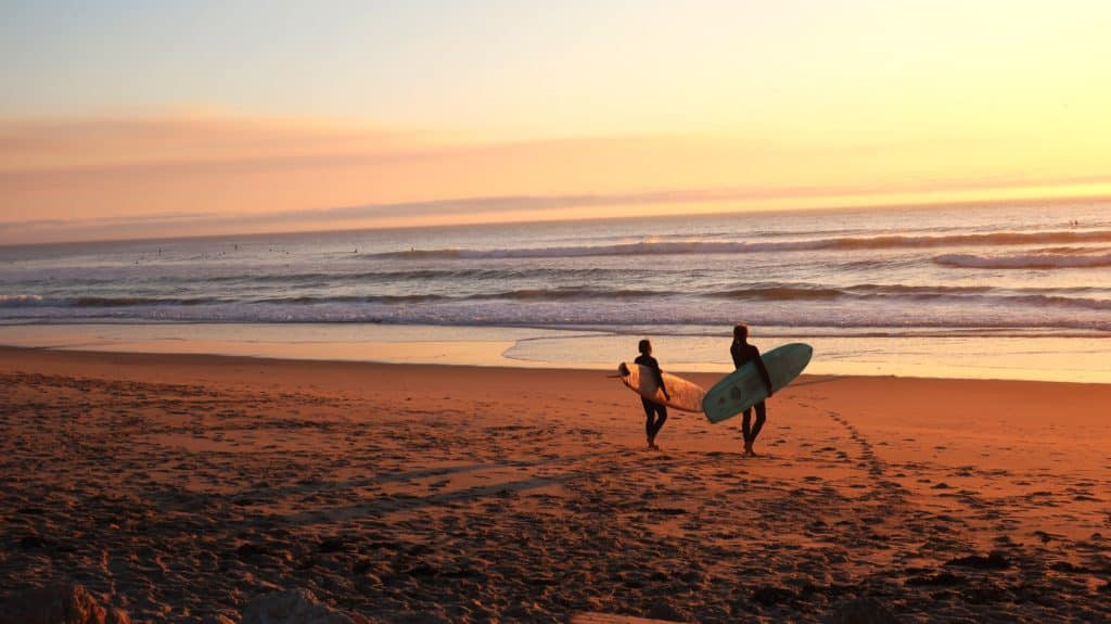 Two surfers walking to the sea